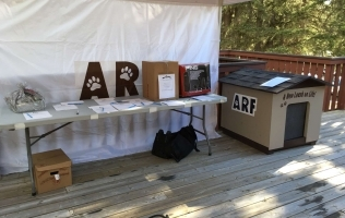 NRG Donates custom dog house to Animal Rescue Foundation Charity Golf Tournament