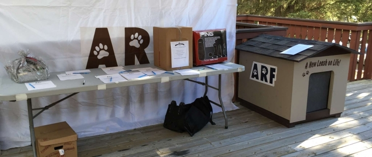 NRG Donates custom dog house to Animal Rescue Foundation Charity Golf Tournament